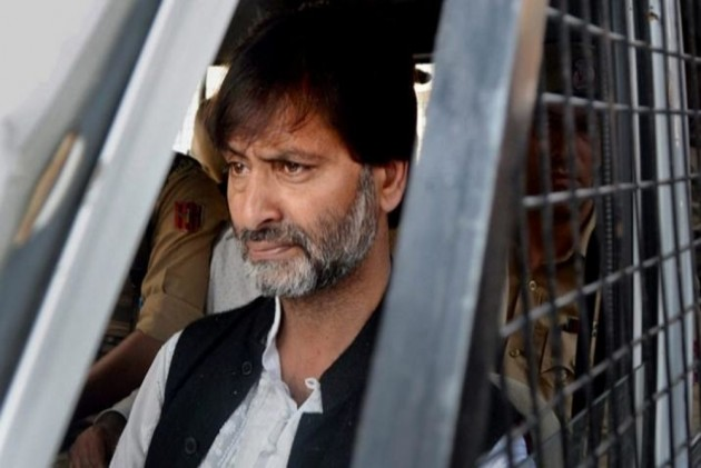 Kashmiri Separatist leader Yasin Malik being brought to NIA headquarters in Delhi, ourvoice, werIndia