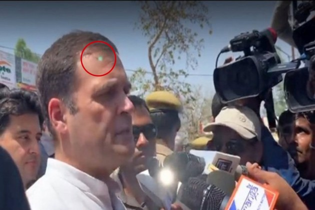 congress claims laser light on rahul gandhi a security scare, spg blames aicc photographer