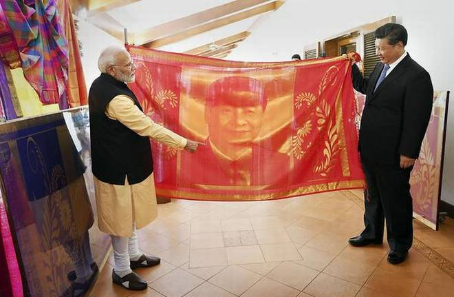 PM Modi presents Chinese President with silk shawl showing Indian craftsmanship